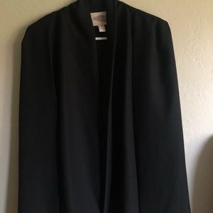 Vest with a cape attached